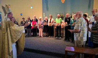 Bishop Mathes blesses the Legacy Society during 2016 visit